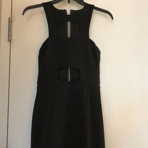 Black full length dress with deep slit.